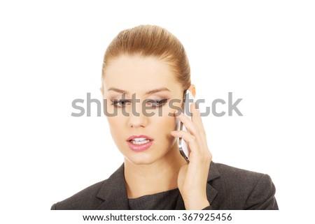 Businesswoman talking on mobile phone. - stock photo