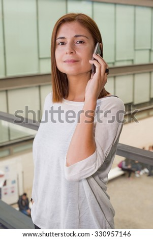 businesswoman talking on mobile phone in office building