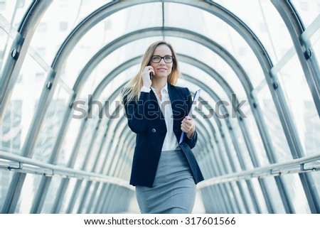 Businesswoman talking on the mobile phone  - stock photo