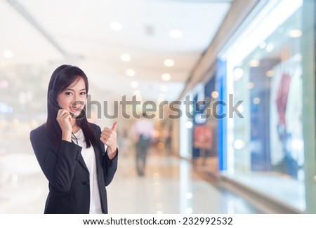 businesswoman talking on the phone while working at the office  - stock photo