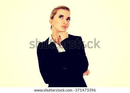 Businesswoman thinking about some idea - stock photo