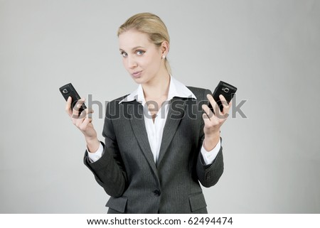 Businesswoman thinking about which mobile phone is better