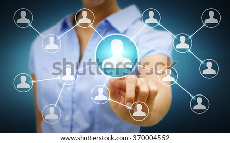 Businesswoman touching digital screen with social network connection