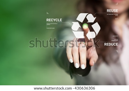 Businesswoman touching recycling symbol on  touch screen. Environmental concept recycle - reduce - reuse. - stock photo