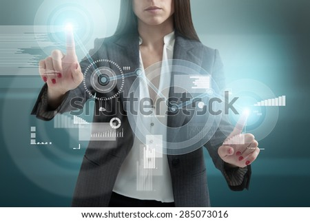 businesswoman touching the virtual screen with charts and diagrams - stock photo