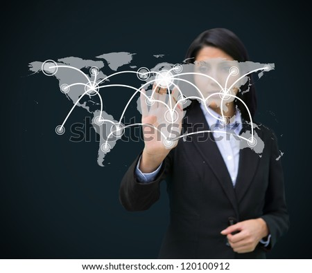 Businesswoman touhing holographic world map with connecing lines - stock photo