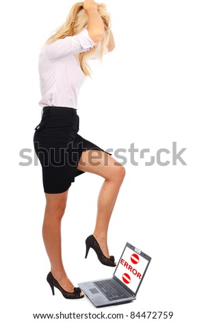 Businesswoman trample laptop with error message on screen, easily replaceable with your own text - stock photo