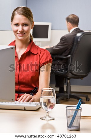 Businesswoman typing on computer at desk - stock photo