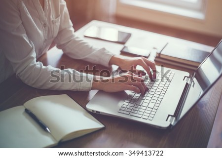 Businesswoman typing on laptop at workplace Woman working in home office hand  keyboard - stock photo
