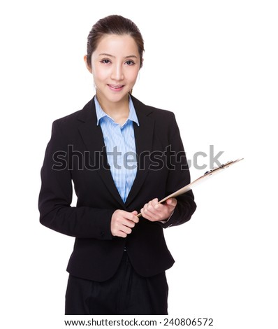 Businesswoman use of clipboard
