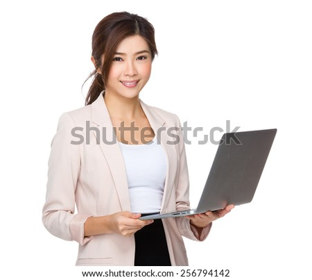 Businesswoman use of laptop - stock photo