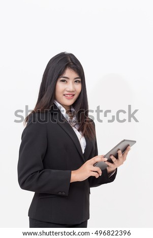Businesswoman uses digital tablet