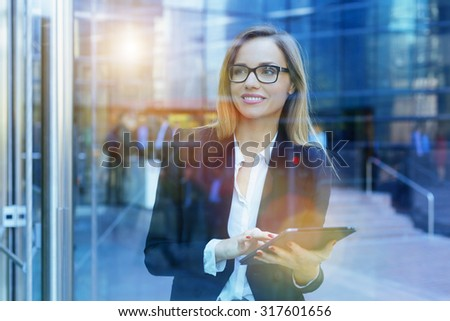 Businesswoman using a digital tablet - stock photo