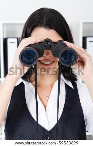 businesswoman using binoculars - stock photo