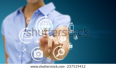 Businesswoman using digital interface with her fingers