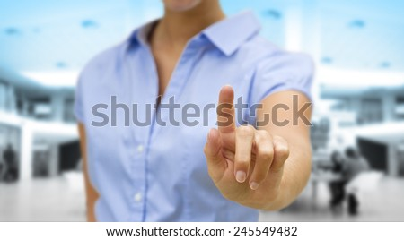 Businesswoman using digital interface with her fingers - stock photo