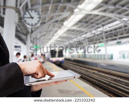 Businesswoman using digital tablet in skytrain station - stock photo