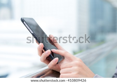 Businesswoman using her smart phone