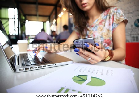 businesswoman using internet on smart phone and laptop - stock photo