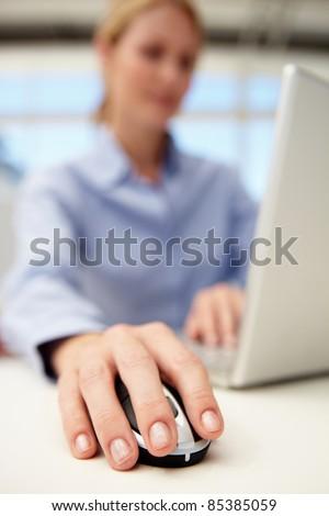Businesswoman using laptop - stock photo