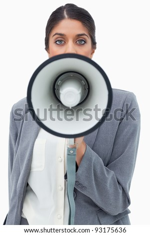 Businesswoman using megaphone against a white background