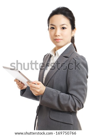 Businesswoman using tablet - stock photo
