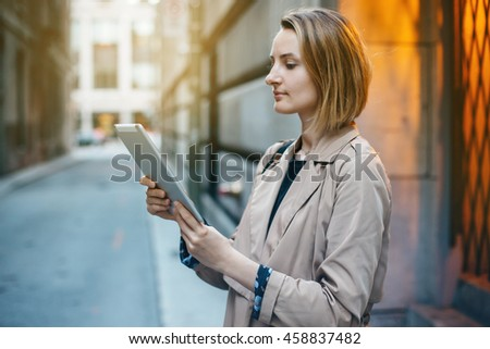 Businesswoman using tablet and smartphone while working on new project, cityscape, Blurred background, flare light, Shallow DOF