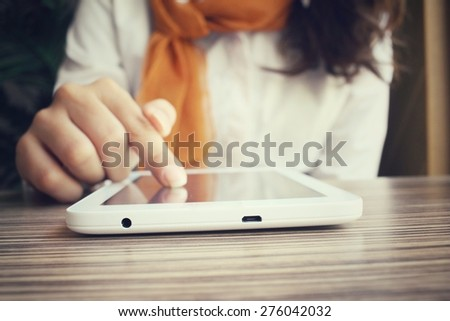 Businesswoman using tablet in the cafe - stock photo