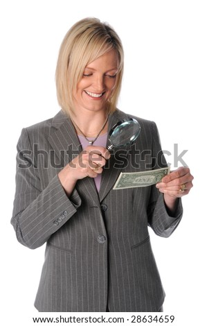 Businesswoman viewing dollar bill through magnifying glass isolated over white background
