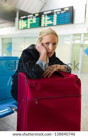 businesswoman waiting for their departure at the airport. symbolic photo for waiting times, flight cancellations and strikes. - stock photo