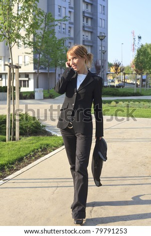 businesswoman walking - stock photo