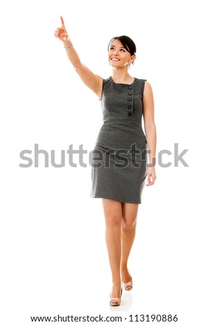 Businesswoman walking and pointing away - isolated over a white background