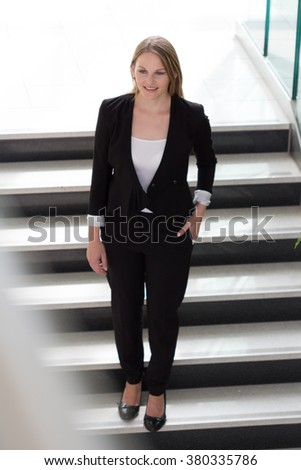 Businesswoman walking down a staircase