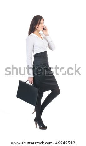 Businesswoman walking over white background - stock photo