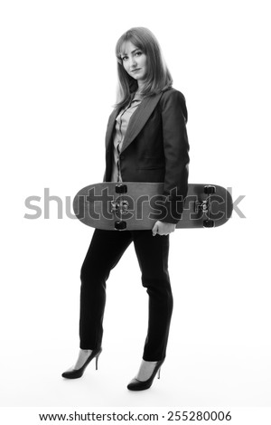 businesswoman wearing a suit with a skateboard  - stock photo