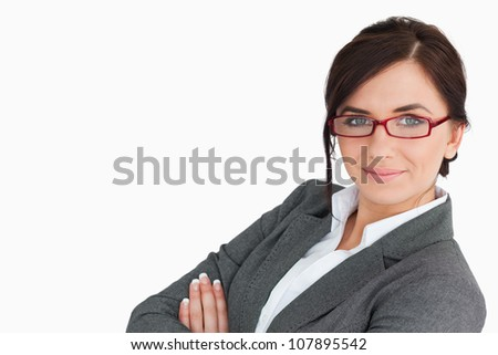 Businesswoman wearing red glasses against white background