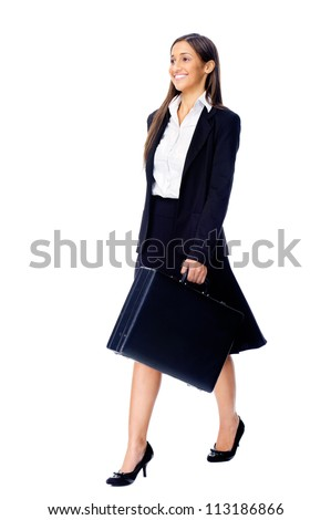 Businesswoman wearing suit walking with briefcase isolated on white background - stock photo