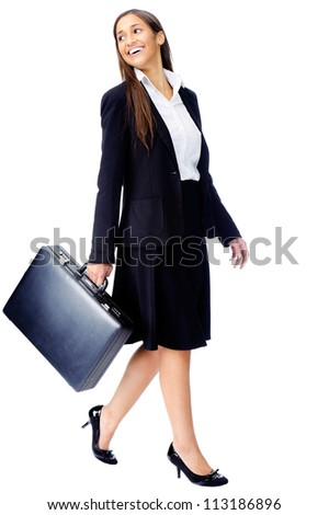 Businesswoman wearing suit walking with briefcase isolated on white background