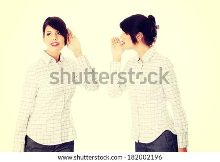 Businesswoman whispering gossip - stock photo