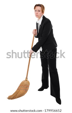 Businesswoman with a broom is cleaning the ground - stock photo