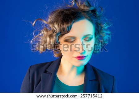 businesswoman with a chic hairstyle. portrait in the studio - stock photo