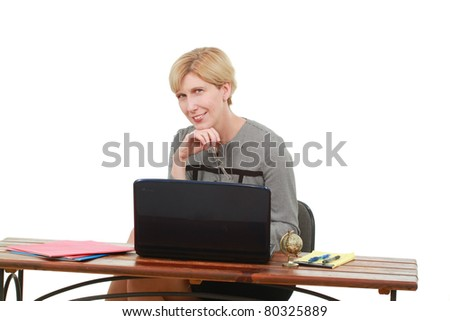 Businesswoman with a laptop at a desk - stock photo