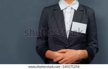 Businesswoman with a name tag on the chest, space for text - stock photo