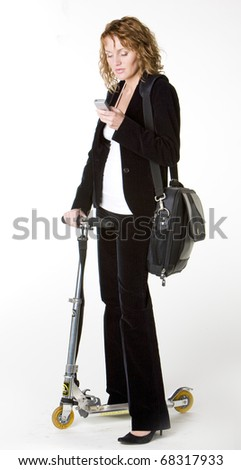 businesswoman with a scooter - stock photo