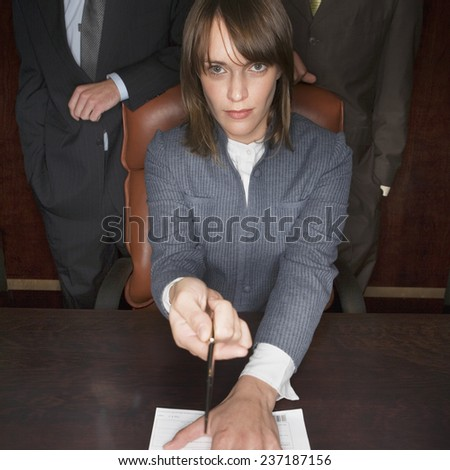 Businesswoman with Ballpoint Pen and Document - stock photo