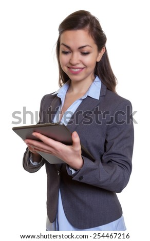 Businesswoman with brown hair loves her tablet computer
