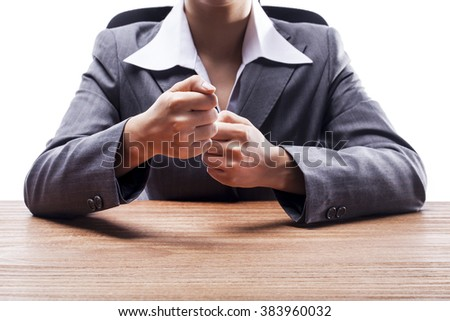 Businesswoman with clenched fists ready to fight. - stock photo