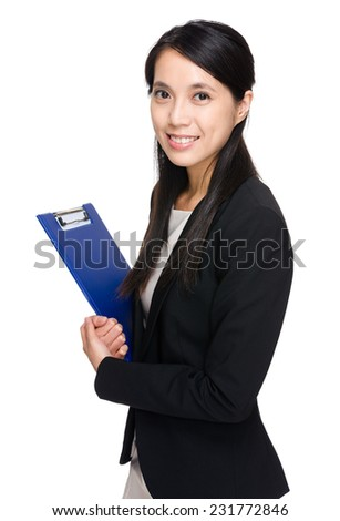 Businesswoman with clipboard - stock photo