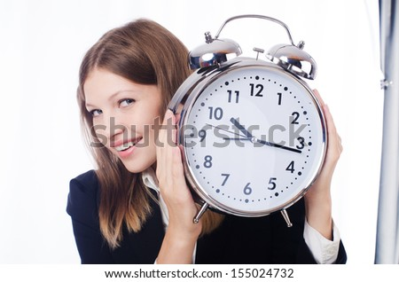 Businesswoman with clock isolated on white - stock photo