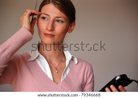 Businesswoman with confused expression trying to remember something - stock photo